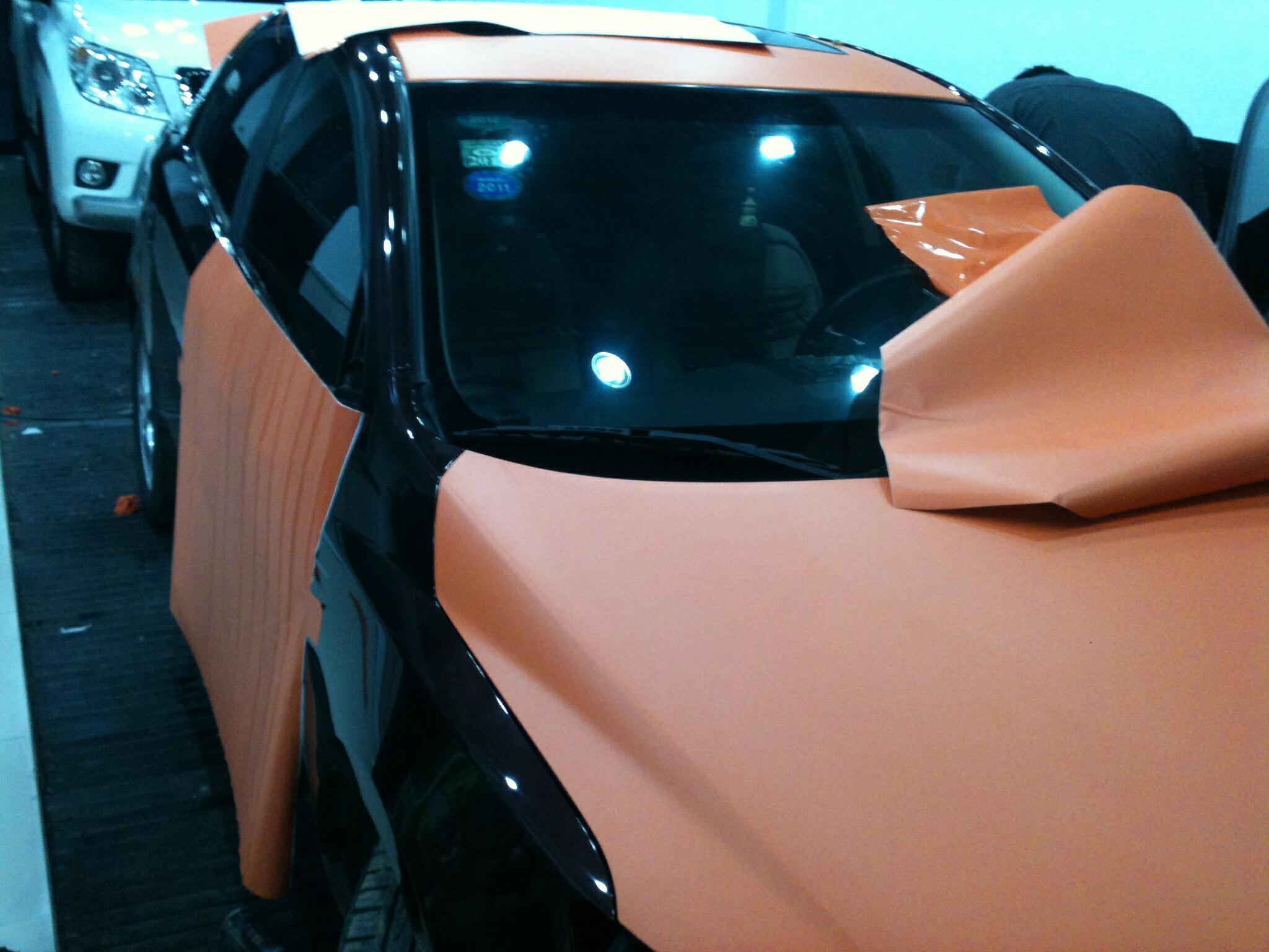 丽车坊酷车改色作品   深酒白色福瑞迪改磨砂橙+米奇车贴